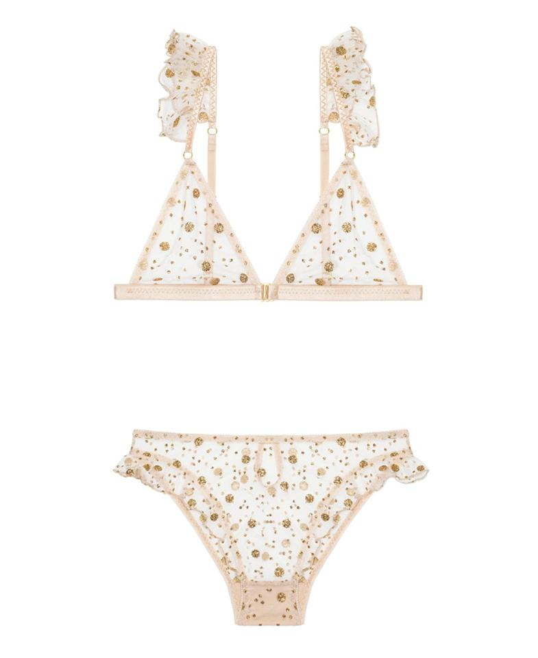 """Dreary winter mornings call for the prettiest, mood-lifting lingerie in your closet. Le Petit Trou's shimmery tulle and ruffle-trimmed lingerie is the perfect mix of woodland nymph and European cool girl. $95, Journelle. <a href=""""https://www.journelle.com/products/le-petit-trou-passade-bralette-146275-sale?"""">Get it now!</a>"""