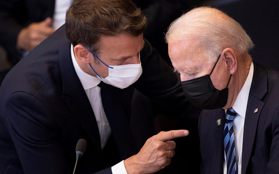 oe Biden, right, speaks with French President Emmanuel Macron during a plenary session during a NATO summit