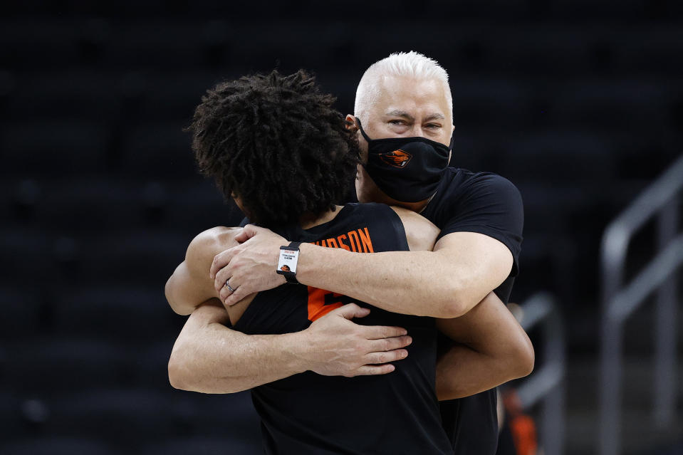 Oregon State coach Wayne Tinkle hugs Ethan Thompson after defeating Loyola Chicago on March 27. (Tim Nwachukwu/Getty Images)