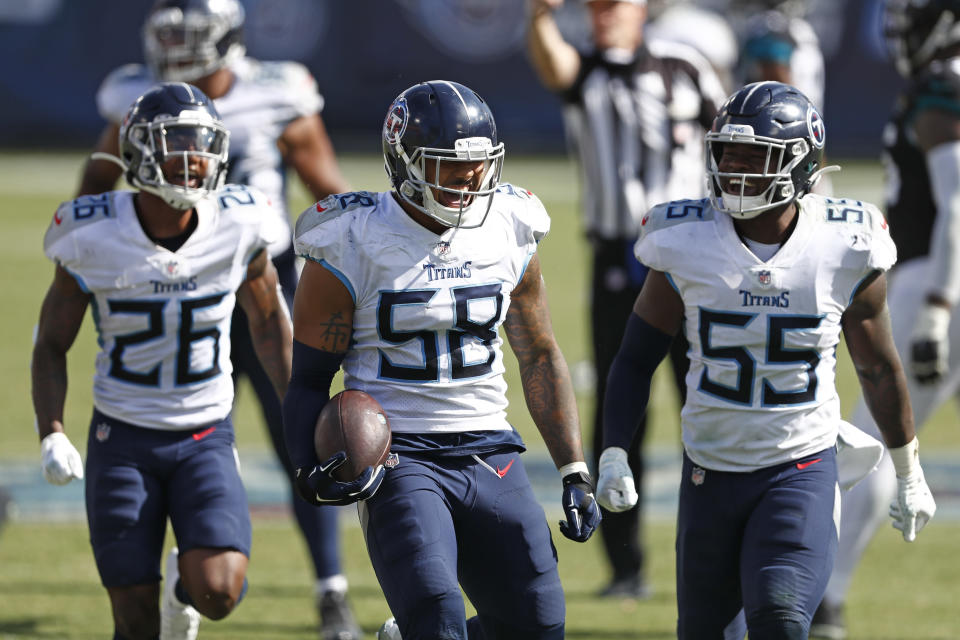 Tennessee Titans linebacker Harold Landry (58) celebrates after intercepting a pass to stop the final drive of the Jacksonville Jaguars in the fourth quarter of an NFL football game Sunday, Sept. 20, 2020, in Nashville, Tenn. The Titans won 33-30. (AP Photo/Wade Payne)
