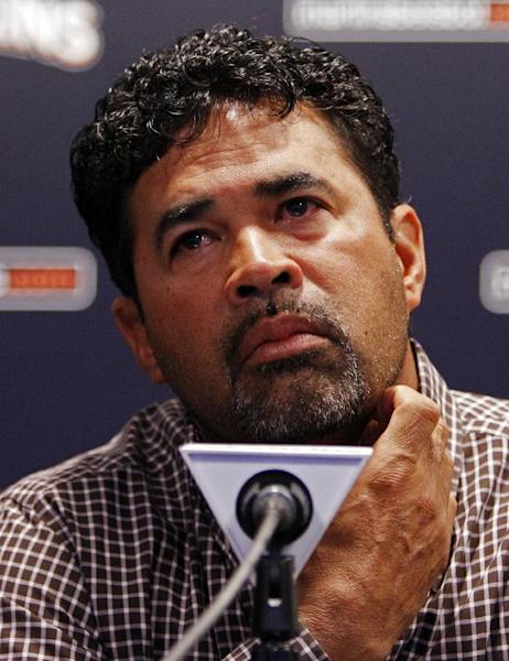 Miami Marlins manager Ozzie Guillen speaks at a news conference at Marlins Stadium in Miami, Tuesday April 10, 2012. Guillen was suspended for five games Tuesday because of his comments about Fidel Castro. Guillen told Time magazine he loves Castro and respects the retired Cuban leader for staying in power so long. At least two local officials said Guillen should lose his job. (AP Photo/Lynne Sladky)