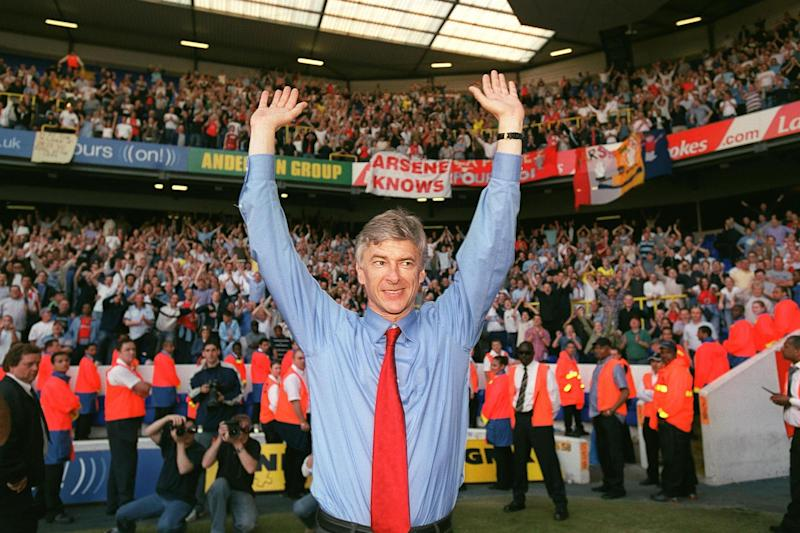 Wenger celebrates winning the Premier League at White Hart Lane in 2004: Arsenal FC via Getty Images