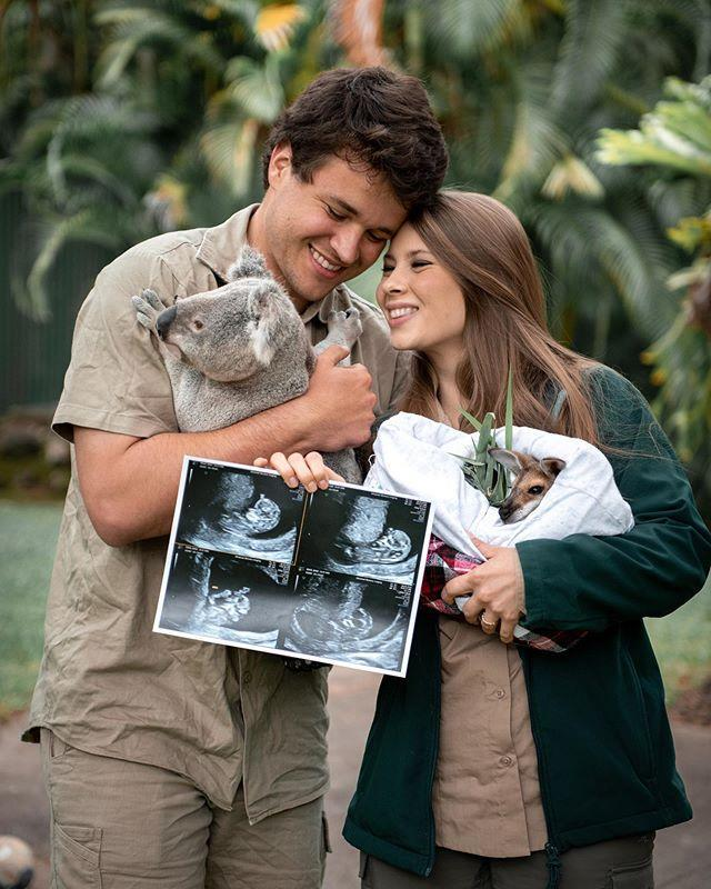"<p>The happy couple posed with a koala and kangaroo to <a href=""https://www.instagram.com/p/CFDJgfRB_Uu/"" rel=""nofollow noopener"" target=""_blank"" data-ylk=""slk:show off their first ultrasound."" class=""link rapid-noclick-resp"">show off their first ultrasound.</a> </p> <p>""The animal joeys we care for are excited to meet our human joey. ❤️,"" Bindi wrote. ""Baby Wildlife Warrior is about the size of a hummingbird now! We can't wait to teach our little one about the importance of protecting our planet and the beauty of the wildlife and wild places we love so much. Thank you for your kindness and support on this magical journey.""</p>"