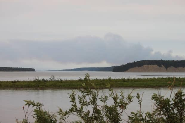 Smoke from a wildfire, which led to the closure of a Highway 1 between Fort Simpson and Wrigley in the N.W.T., can be seen in this photo taken in Fort Simpson on July 9, 2021. (Hannah Paulson/CBC - image credit)