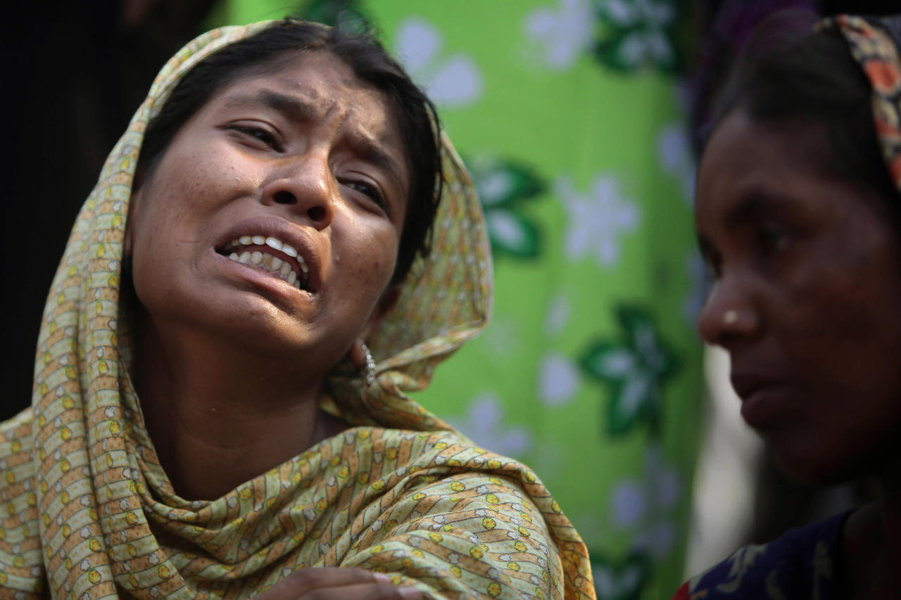 A Bangladeshi relative of a victim cries at the site of a building that collapsed Wednesday in Savar, near Dhaka, Bangladesh,Thursday, April 25, 2013. By Thursday, the death toll reached at least 194 people as rescuers continued to search for injured and missing, after a huge section of an eight-story building that housed several garment factories splintered into a pile of concrete. (AP Photo/A.M.Ahad)