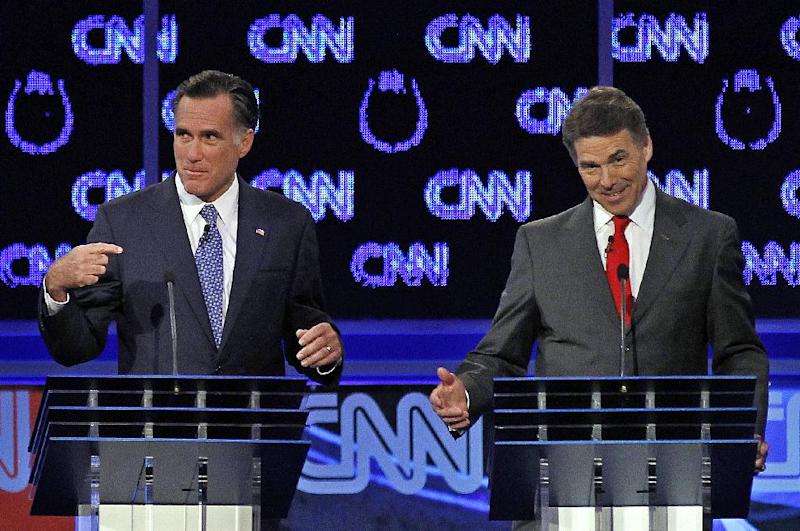 """FILE - In this Oct. 18, 2011, file photo Republican presidential candidates Mitt Romney and Rick Perry, right, spar during a Republican presidential debate in Las Vegas. Perry, still nursing wounds from his failed presidential campaign, did himself a world of good with his self-deprecating jokes at a dinner in Washington in March. First, he joked that his time as the GOP front-runner had been """"the three most exhilarating hours of my life."""" Then he perfectly skewered Romney by quipping that during the GOP debates, he'd been tempted to turn to his rival and ask, """"Pardon me, do you have any Grey Poupon?"""" (AP Photo/Chris Carlson, File)"""