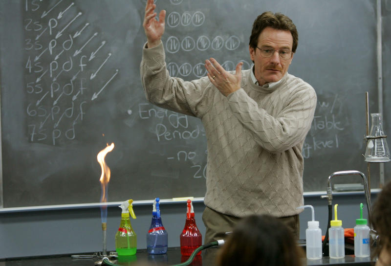 """This image released by AMC shows Walter White, played by Bryan Cranston, teaching chemistry class in a scene from the pilot episode of """"Breaking Bad."""" The series finale of the popular drama series airs on Sunday, Sept. 29. (AP Photo/AMC, Doug Hyun)"""