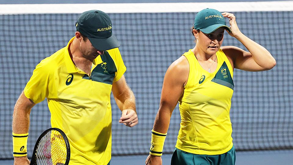 Ash Barty (pictured right) and John Peers (pictured left) looking dejected during the semi-final of mixed doubles at the Tokyo Olympics.