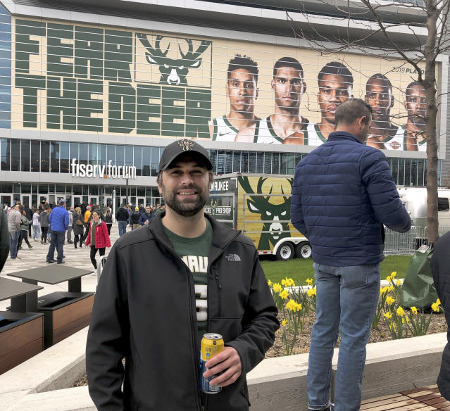 In this May 8, 2019 photo, Hunter Trimmel, 37, a Milwaukee resident who has been a Bucks fan since 1992, poses for a photo outside the Milwaukee Bucks' Fiserv Forum stadium before last Wednesday's game. (AP Photo/Ivan Moreno)