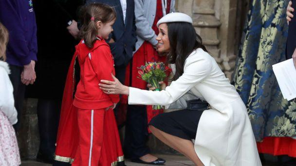 PHOTO: Actress Meghan Markle, fiancee of Britain's Prince Harry, receives a posy of flowers from a young girl after attending a Commonwealth Day Service at Westminster Abbey in central London, March 12, 2018. (Daniel Leal-Olivas/AFP/Getty Images)