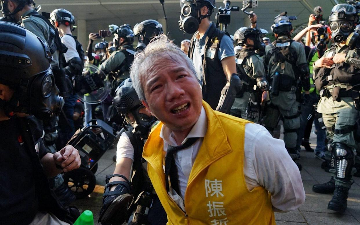 Police attacked the silver-haired Richard Chan, 48, at close range - Jasmine Leung