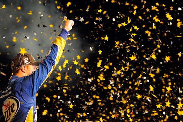 HOMESTEAD, FL - NOVEMBER 18: Brad Keselowski, driver of the #2 Miller Lite Dodge, celebrates in Champion Victory Lane after winning the series championship and finishing in fifteenth place for the NASCAR Sprint Cup Series Ford EcoBoost 400 at Homestead-Miami Speedway on November 18, 2012 in Homestead, Florida. (Photo by Jared C. Tilton/Getty Images for NASCAR)