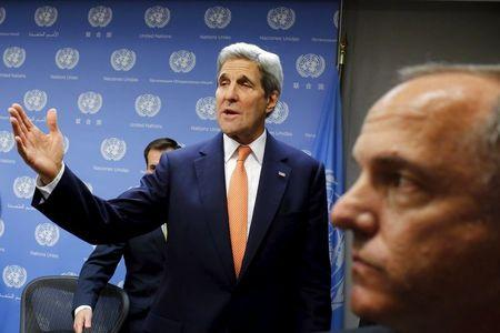 U.S. Secretary of State Kerry exits the room after a news conference at the United Nations Headquarters in Manhattan, New York