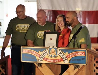 SWRCC EST Dan Langford, SWRCC VP Frank Hawk, and SWRCC President Pete Rodriguez accept a proclamation from Phoenix Mayor Kate Gallego designating February 29th as Solidarity Day in Phoenix.