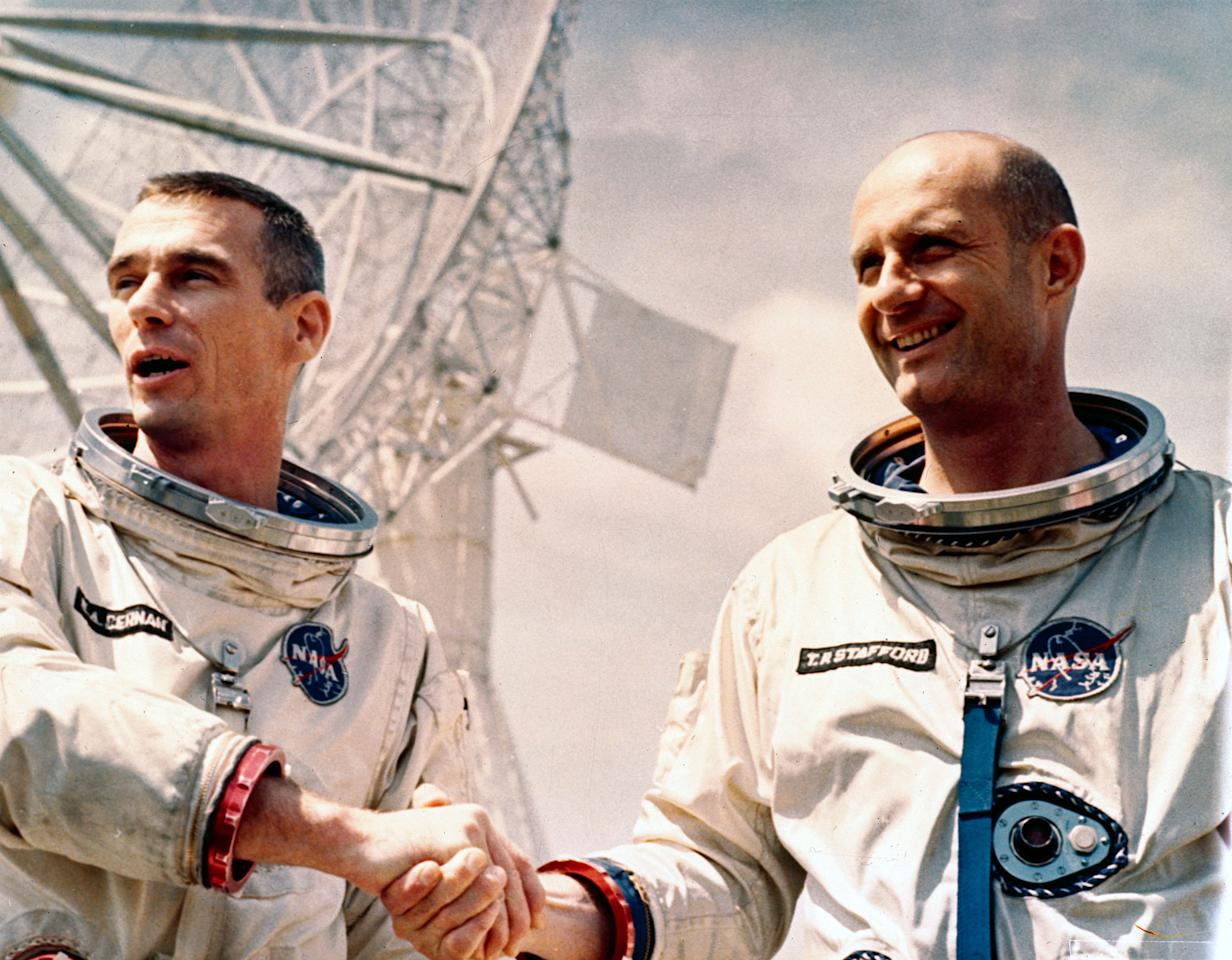 <p>Thomas Stafford and Eugene Cernan crewed Gemini 9 which was launched on 3rd June 1966. This spacecraft failed to complete a docking manoeuvre but two hours of extra vehicular activity (EVA), a spacewalk, were accomplished. The astronauts are shown in their spacesuits, shaking hands. The achievements of the Gemini missions were vital for developing the Apollo programme that put the first astronauts on the Moon in 1969. Both Stafford and Cernan flew on Apollo 10, the mission which served as the dress rehearsal for the first lunar landing, and Cernan was the commander of Apollo 17, the last manned mission to the Moon which took place in 1972. (SSPL/Getty Images) </p>