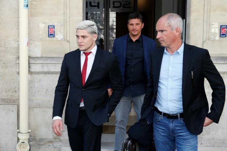 Australian international James O'Connor (L) leaves after appearing before the French National Rugby League (Ligue Nationale de Rugby, LNR) disciplinary commission in Paris on April 12, 2017, after being arrested for cocaine possession