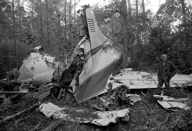The wreckage of a twin-engine Convair 240 plane lies in a wooded area near McComb, Miss., on Oct. 20, 1977. The small plane had 26 people onboard, and six were killed in the crash, including three members of Lynyrd Skynyrd. (Photo: AP)