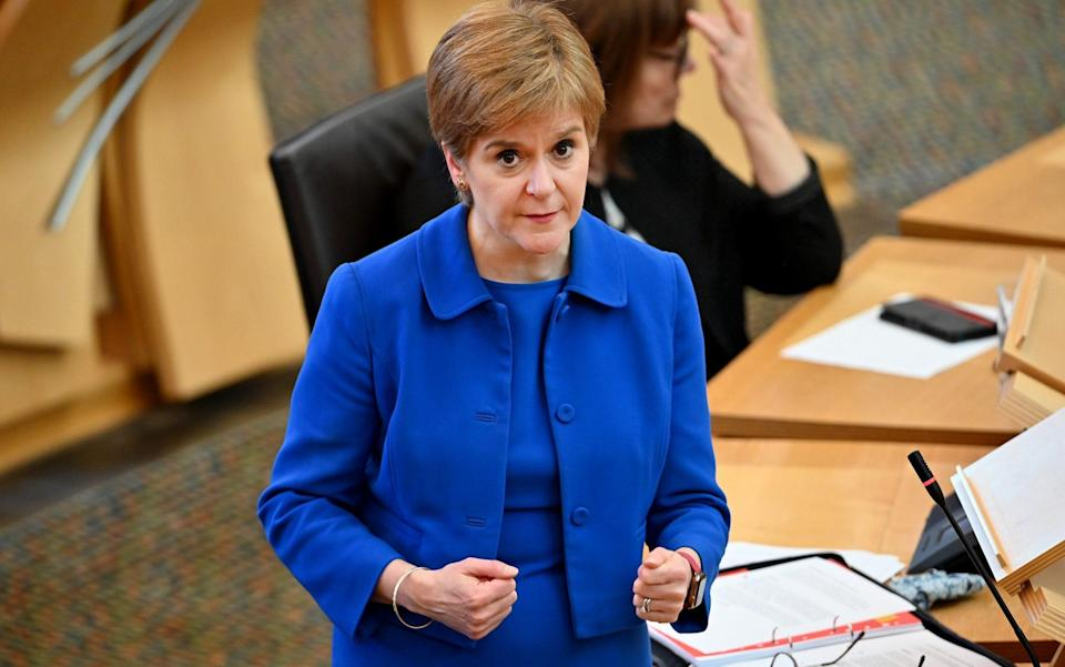First Minister Nicola Sturgeon announces her plans to halt the spread of coronavirus at the Scottish Parliament - Getty Images Europe