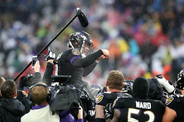 Baltimore Ravens teammates carry kicker Justin Tucker off the field after his 49-yard game-winning field goal. (Rob Carr/Getty Images)