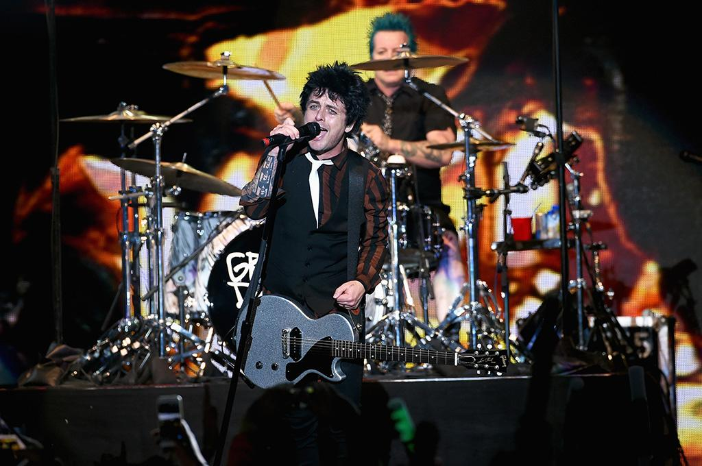<p>Billie Joe Armstrong and drummer Tré Cool of the band Green Day perform at 106.7 KROQ Almost Acoustic Christmas 2016 — Night 2 at the Forum on Dec. 11, 2016, in Inglewood, Calif. (Photo: Kevin Winter/Getty Images for CBS Radio) </p>