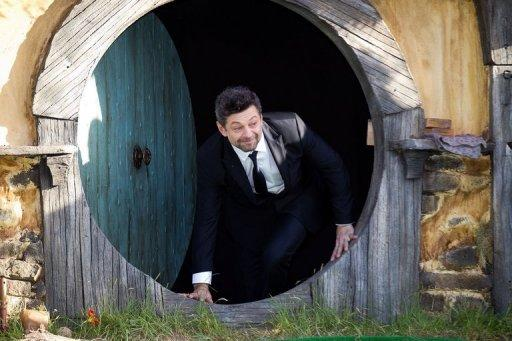 """Actor Andy Serkis walks out onto the stage at the world premiere of """"The Hobbit"""" in Wellington on November 28. A huge roar erupted as the cast slowly made their way down the red carpet at the New Zealand capital's entertainment strip"""