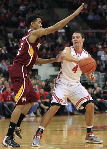 Ohio State's Aaron Craft (4) passes the ball around Winthrop's Gideon Gamble during the first half of an NCAA college basketball game, Tuesday, Dec. 18, 2012, in Columbus, Ohio. (AP Photo/Jay LaPrete)