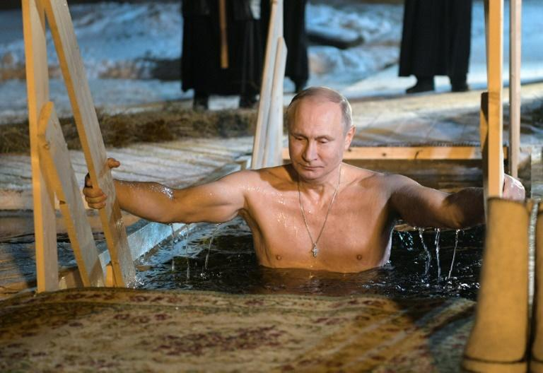 Bare-chested Putin takes dip in icy lake for Epiphany