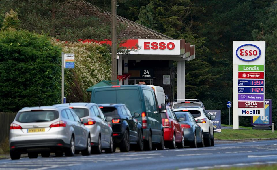 Motorists queue for fuel at an Esso petrol station in Ashford, Kent. Picture date: Monday October 4, 2021.
