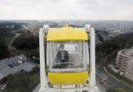 'Amusement Workation' lets teleworkers work from a Ferris wheel and pool side amid the coronavirus disease (COVID-19) outbreak, at Yomiuriland in Tokyo