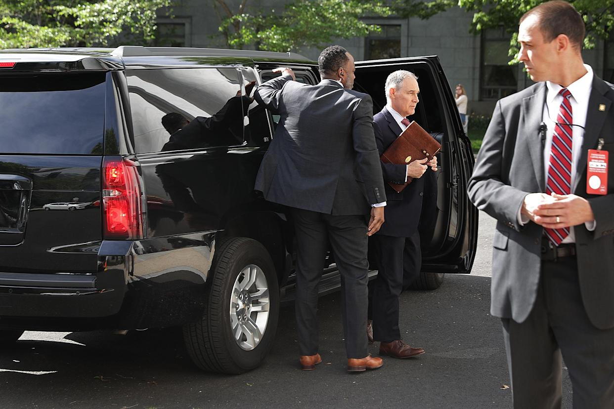 """<span class=""""s1"""">Surrounded by security agents, Scott Pruitt, center, steps out of his armored SUV on Capitol Hill on April 26. (Photo: Chip Somodevilla/Getty Images).</span>"""