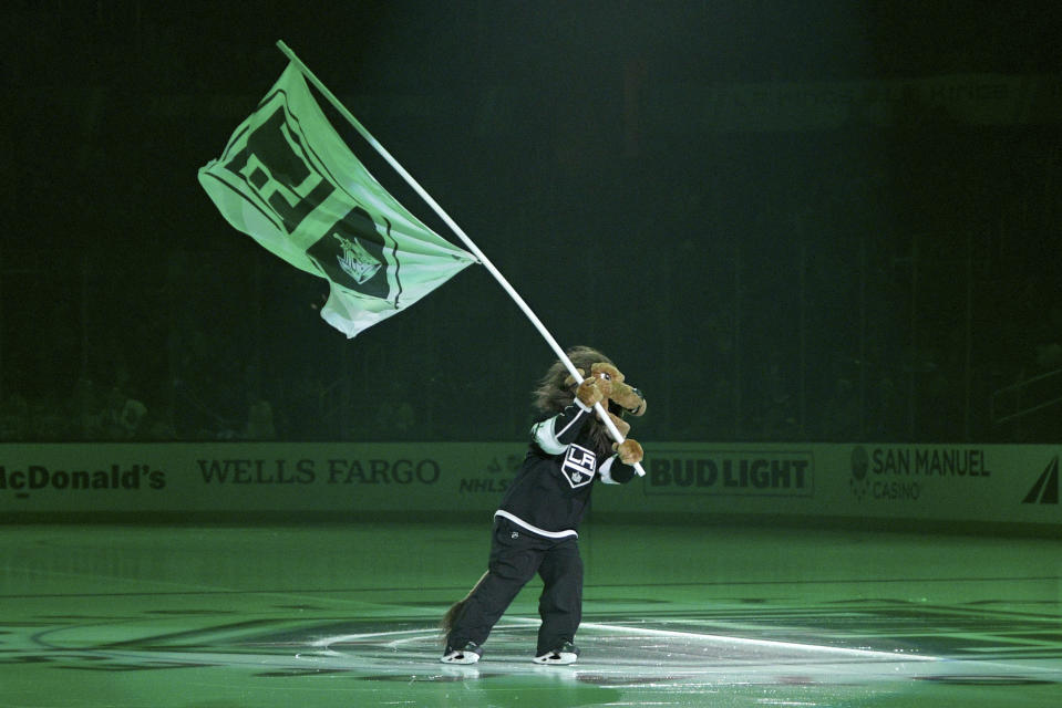 Los Angeles Kings mascot Bailey skates on the ice before an NHL hockey game against the San Jose Sharks, Monday, Nov. 25, 2019, in Los Angeles. (AP Photo/Michael Owen Baker)