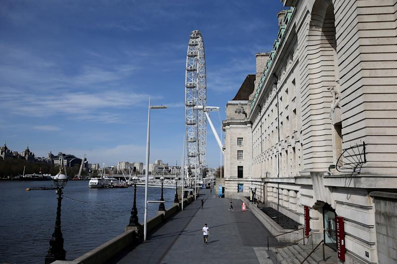 An almost empty pavement is pictured on the South Bank, by the River Thames, with the landmark the London Eye beyond, in central London on April 7, 2020, as life in Britain continues during the nationwide lockdown to combat the novel coronavirus pandemic. - British Prime Minister Boris Johnson spent the night in intensive care after being admitted with a deteriorating case of coronavirus, prompting serious concerns on Tuesday about his health and the government's response to a still-escalating outbreak. (Photo by ISABEL INFANTES / AFP) (Photo by ISABEL INFANTES/AFP via Getty Images)