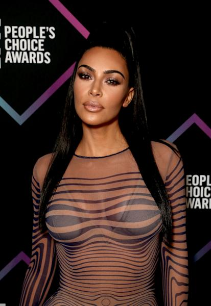 The 38-year-old reality star wore a completely see-through body-hugging dress to the 2018 People's Choice Awards. See it here.