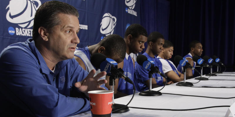 Kentucky head coach John Calipari, left, speaks during a news conference, Saturday, March 24, 2012, in Atlanta. Kentucky is scheduled to play Baylor in the NCAA college basketball tournament South Regional finals on Sunday, March 25. (AP Photo/David J. Phillip)