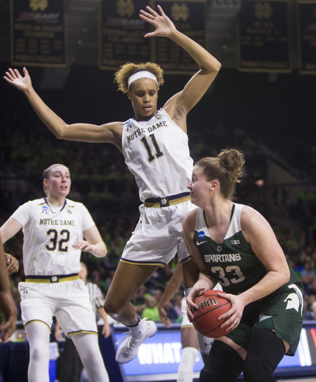 Michigan State's Jenna Allen (33) looks for a shot with pressure from Notre Dame's Brianna Turner (11) during a second-round game in the NCAA women's college basketball tournament in South Bend, Ind., Monday, March 25, 2019. (AP Photo/Robert Franklin)