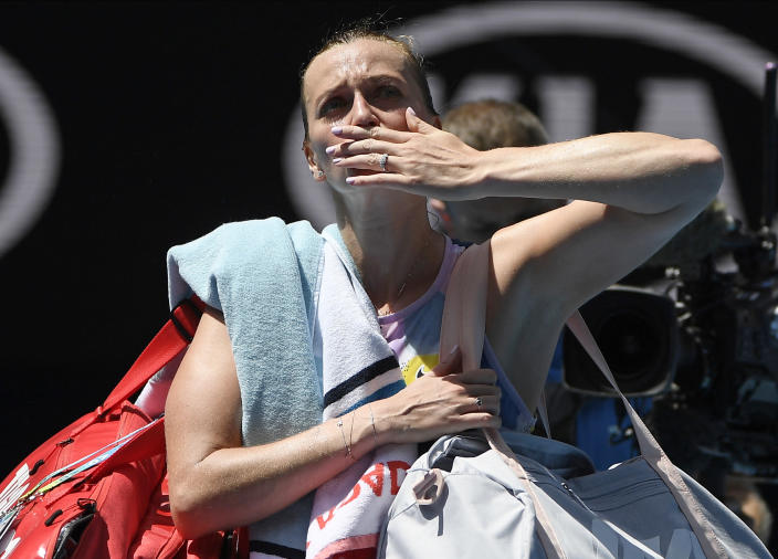 Petra Kvitova of the Czech Republic blows a kiss to the crowd as she leaves Rod Laver Arena following her quarterfinal loss to Australia's Ashleigh Barty at the Australian Open tennis championship in Melbourne, Australia, Tuesday, Jan. 28, 2020. (AP Photo/Andy Brownbill)