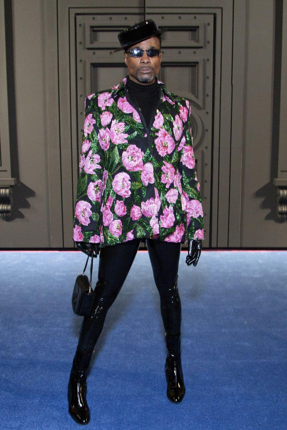 <p>Porter at Richard Quinn's fall 2020 fashion show in a floral blazer, black spandex leggings, and a hat. </p>