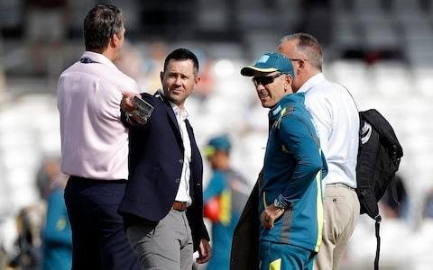 An Aussie conflab out in the middle between Justin Langer (right), Ricky Ponting (centre) and Glenn McGrath (left) - Credit: getty images