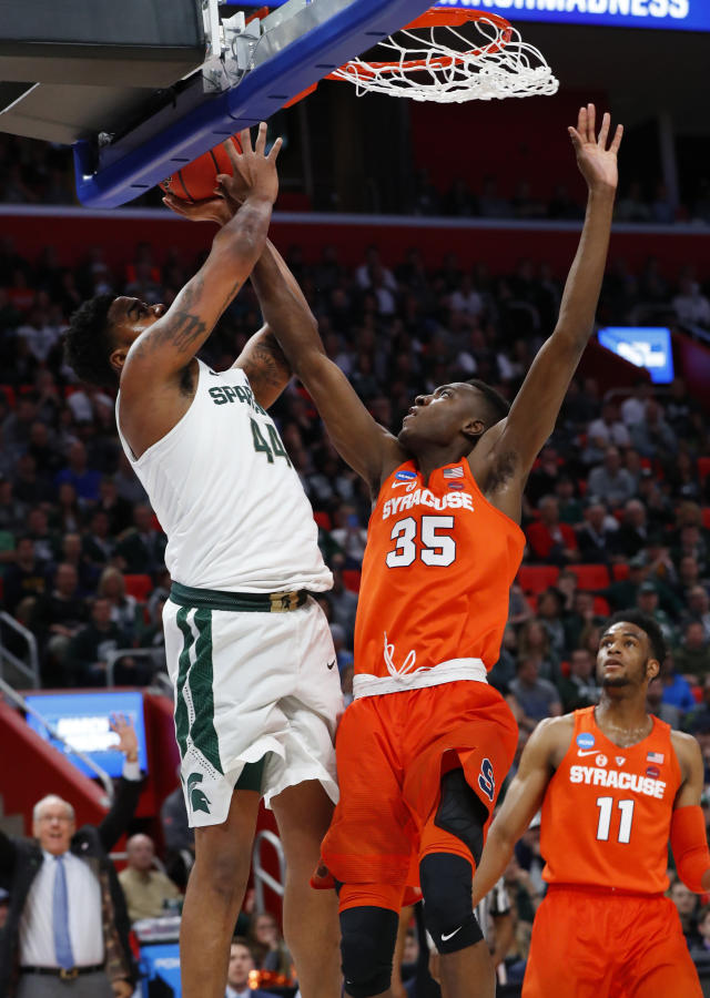 Michigan State forward Nick Ward (44) drives on Syracuse forward Bourama Sidibe (35) during the first half of an NCAA men's college basketball tournament second-round game in Detroit, Sunday, March 18, 2018. (AP Photo/Paul Sancya)