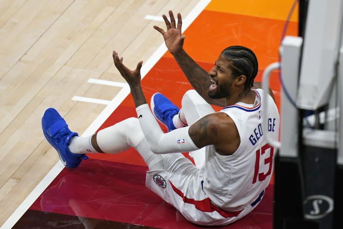 Los Angeles Clippers guard Paul George (13) argues with an official during the second half of Game 2 of the team's second-round NBA basketball playoff series against the Utah Jazz on Thursday, June 10, 2021, in Salt Lake City. (AP Photo/Rick Bowmer)
