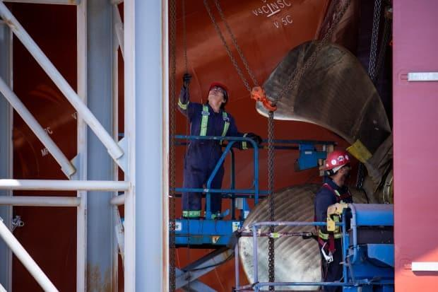 Crews work on two Canadian Coast Guard vessels at the Seaspan Vancouver Shipyards in West Vancouver, British Columbia on Wednesday, May 22, 2019.
