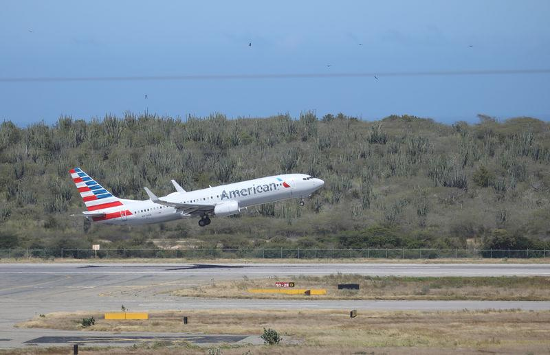 file photo: An American Airlines Boeing 737-800 airplane takes off at Simon Bolivar International Airport in Caracas, Venezuela January 25, 2019. REUTERS/Andres Martinez Casares