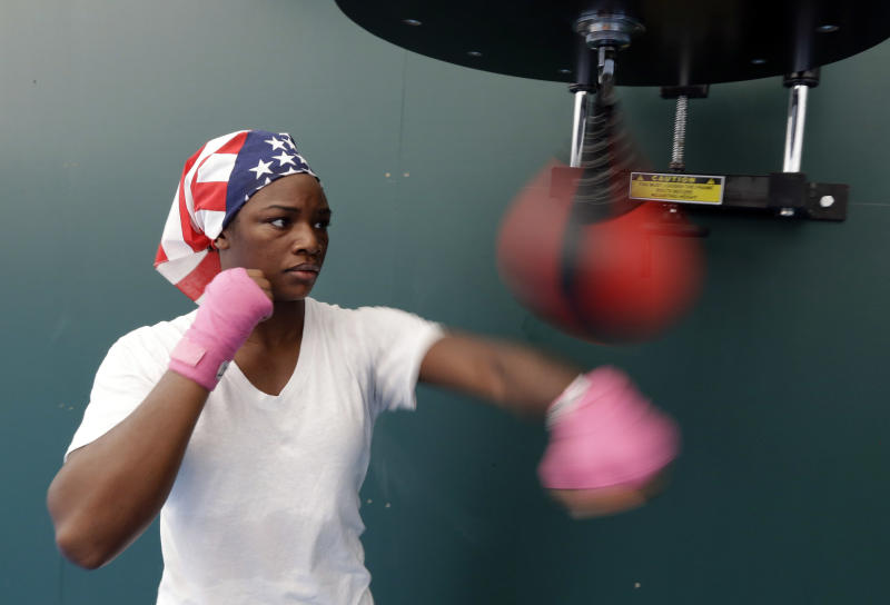 United States' 75-kg middleweight boxer Claressa Shields warms up during a practice session at the 2012 Summer Olympics, Thursday, July 26, 2012, in London. (AP Photo/Patrick Semansky)