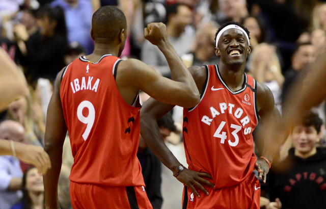 Toronto Raptors' Serge Ibaka (9) and Pascal Siakam (43) celebrate the team's win over the Brooklyn Nets in an NBA basketball game Saturday, Feb. 8, 2020, in Toronto. (Frank Gunn/The Canadian Press via AP)