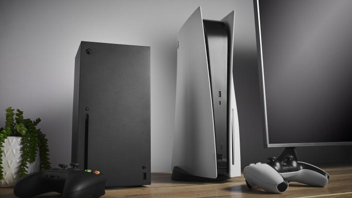 Living room with Microsoft Xbox Series X (L) and Sony PlayStation 5 home video game consoles alongside a television and soundbar, taken on November 3, 2020. (Photo by Phil Barker/Future Publishing via Getty Images)