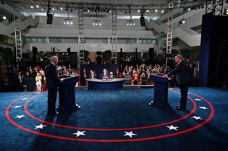 US President Donald Trump (R) and Democratic presidential candidate Joe Biden arrive for the first presidential debate.
