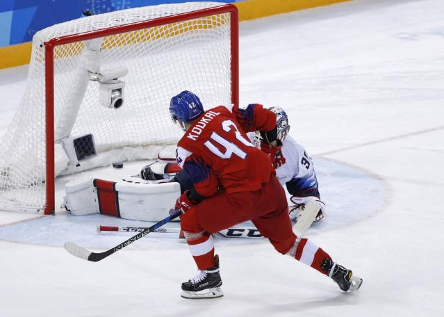 "<a class=""link rapid-noclick-resp"" href=""/olympics/rio-2016/a/1226818/"" data-ylk=""slk:Petr Koukal"">Petr Koukal</a> of the Czech Republic scores on goalie Ryan Zapolski of U.S. in a shootout. (REUTERS)"