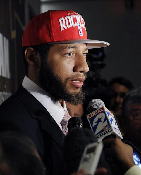 FILE - In this June 29, 2012, file photo, Houston Rockets first-round draft pick Royce White speaks with the media at a newws conference in Houston. In October, NBA rookie Royce White disclosed that he is afraid to fly and said he expects to travel by bus to play in at least some of the basketball games for his team, the Houston Rockets. But psychologists and many travelers who've overcome their terror of airplanes say if he might be able to ditch the bus if he can get treatment for the condition. (AP Photo/Pat Sullivan, File)