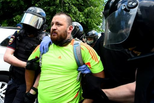 Police detained more than 20 people near the courthouse, rights group OVD-Info said
