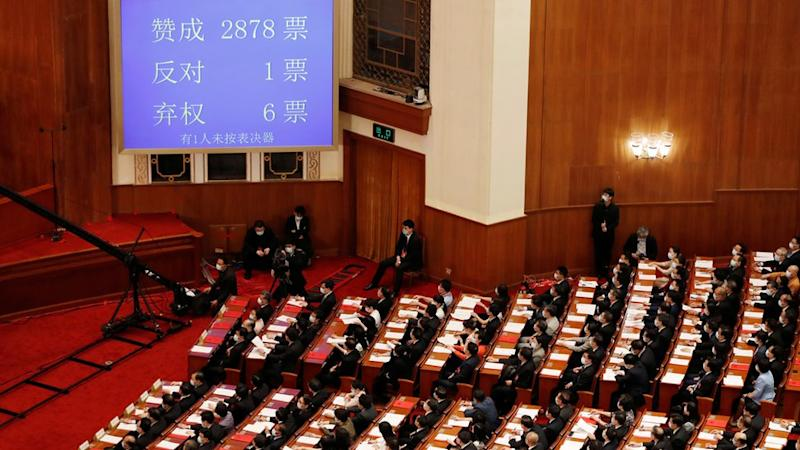 "A screen shows the results of the vote on the national security legislation for Hong Kong Special Administrative Region at the closing session of the National People""s Congress"